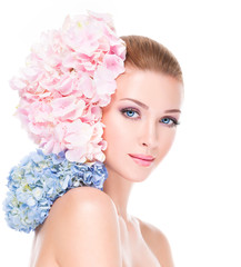 Portrait of young beautiful woman with a healthy clean skin of t