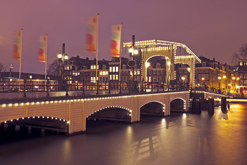 Thiny bridge in Amsterdam the Netherlands by night