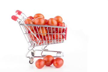 Shopping cart full of tomatoes on a white background