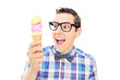 Excited young man holding an ice cream