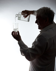 Man, pouring vodka into the glass