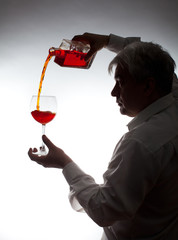 Man, pouring the wine into the glass