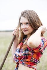 Woman and rake handle adjust long hair