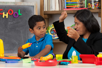 Happy Hispanic Mom with Child in Home School Setting