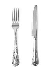 Vintage knife and fork on white background