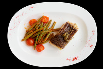Cod fillet with runner beans isolated on black