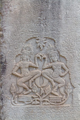 Two Apsaras on the wall of Angkor Wat