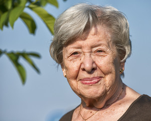 Portrait of Senior Woman Outdoors in the Summer
