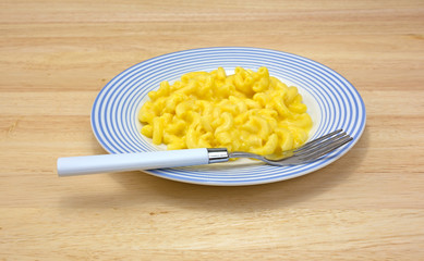 Mac and cheese on plate with fork