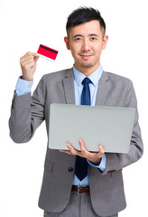 Business man with credit card and computer