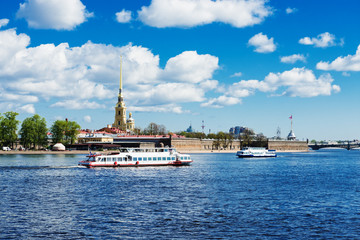Peter and Paul fortress across the Neva with a tourist boat. Sai