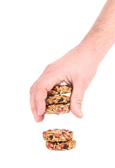 Hand holds candied peanuts sunflower seeds.