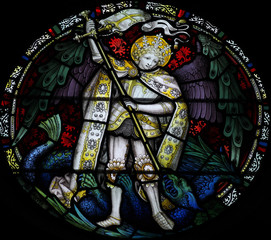 Angel fighting with the dragon in stained glass