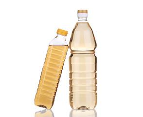 Two bottles of vinegar.