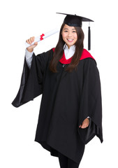 Graduate girl in academic gown with diploma