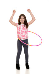 child playing with hula hoop