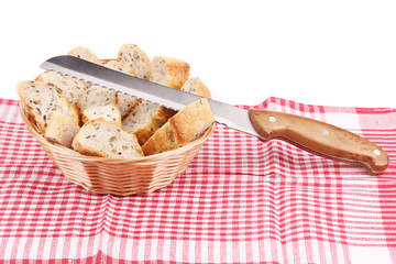 Basket with sliced bread and knife.