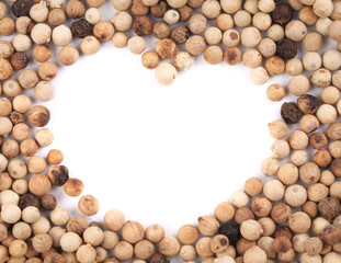 White peppercorn in shape of heart.