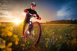 Sport bike, cycling in the beautiful meadow