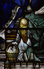Little girl with 2 doves in stained glass