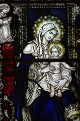 Mary holding her son Jesus in stained glass