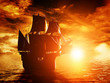 Ancient pirate ship sailing on the ocean at sunset - 66004091