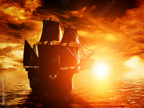 Leinwanddruck Bild Ancient pirate ship sailing on the ocean at sunset