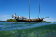 Old sailing boat stranded on a shallow reef
