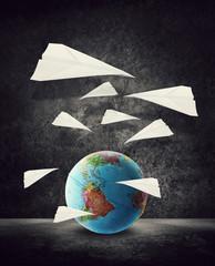 paper planes around globe