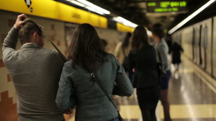 Couple walking out of metro train
