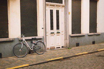 Bicycle in front of a house in Ghent, Belgium