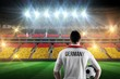 Composite image of germany football player holding ball