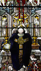 Priest collecting the blood from jesus Christ in stained glass