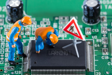 Miniature engineers look at the chip