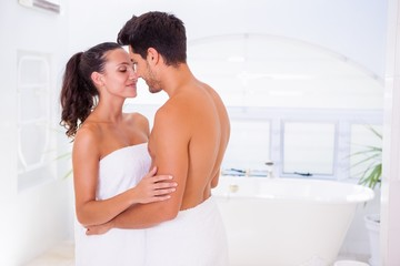 Attractive couple embracing in the morning