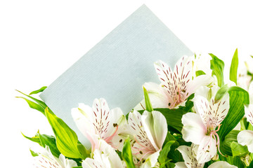 Bunch of white tiger lilies with a blank card