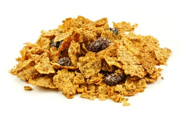 Pile of bran flakes and raisins cereal on a white background