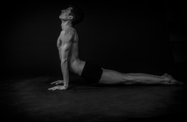 Young man is engaged in yoga