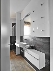washbasin and white furniture in a modern bahtroom