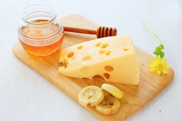 cheese with honey on a board