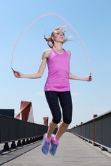 Sport. Attractive girl with skipping rope