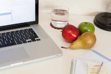 Fruits on an office desk
