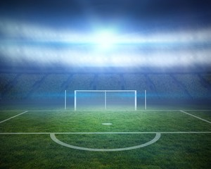 Football pitch with goalpost in stadium