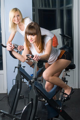 Attractive girls on bicycle