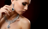 The beautiful woman in expensive pendant - 66011632