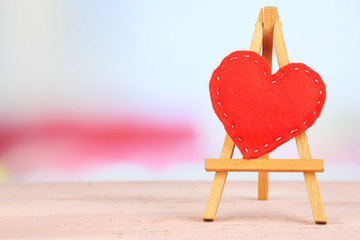 Beautiful heart  small decorative easel on pink table