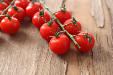 Fresh cherry tomatoes on old wooden table