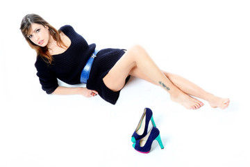 Sensual brunette with blue sweater and shoes