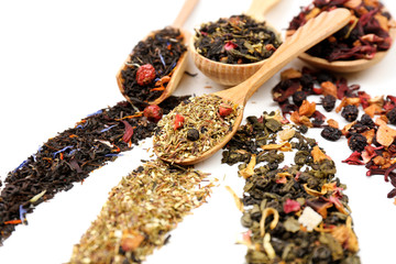 Assortment of dry tea isolated on white