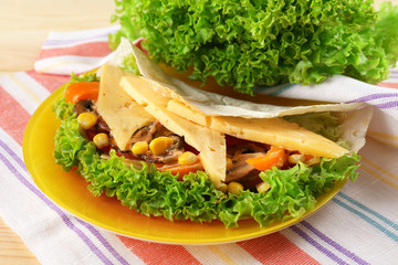 Veggie wrap filled with cheese and fresh vegetables